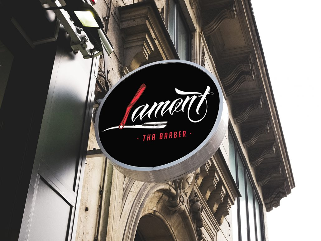 Lamont tha Barber Logo Design on Storefront Sign