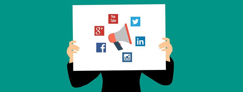 Person holding social media board