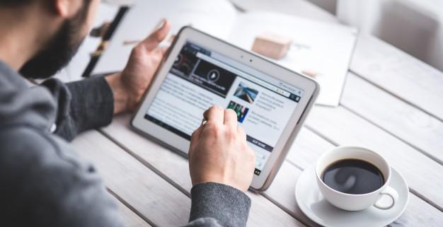 User navigates a website on his tablet