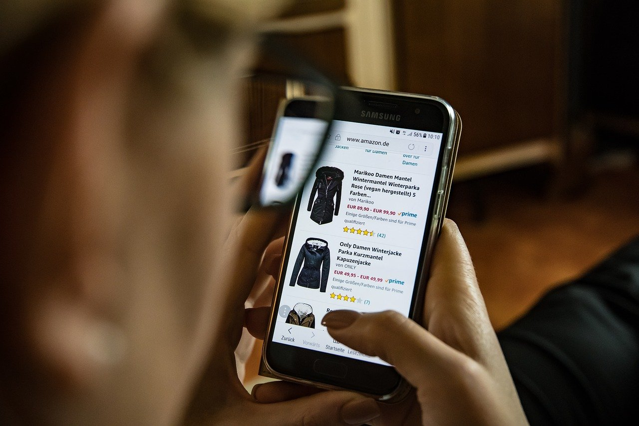 man navigating through an ecommerce store using his phone
