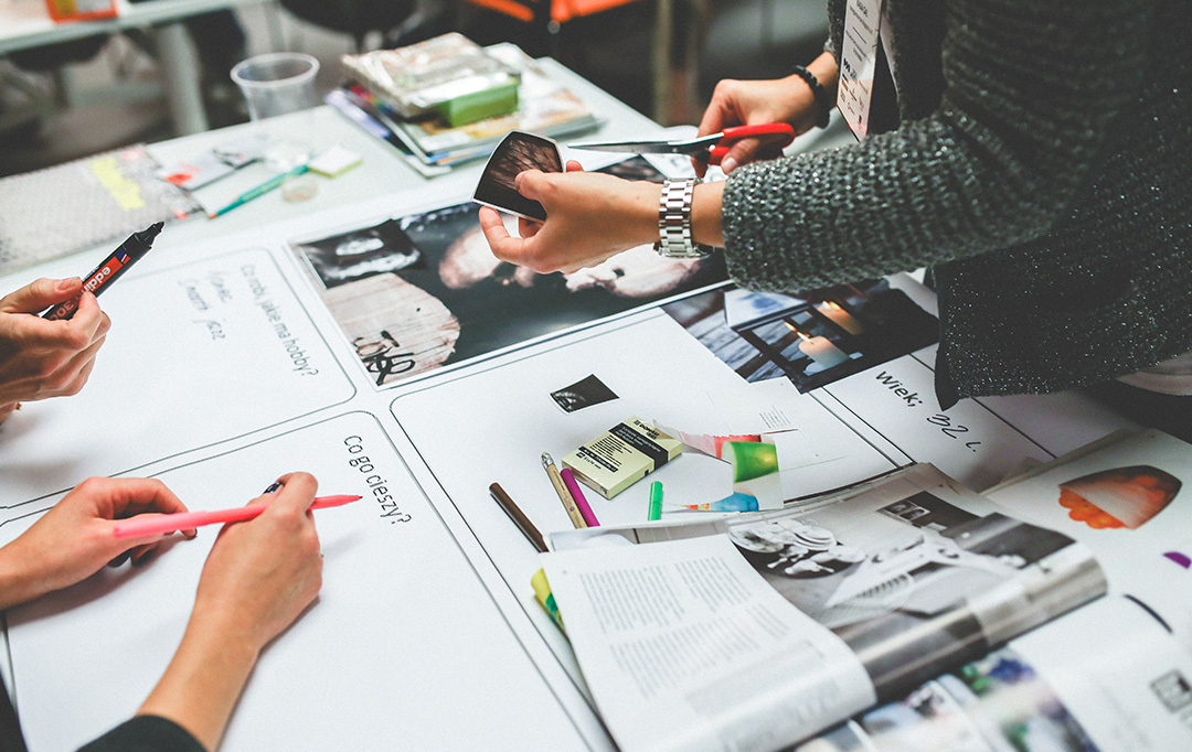 People working together to create brand visuals mockup.