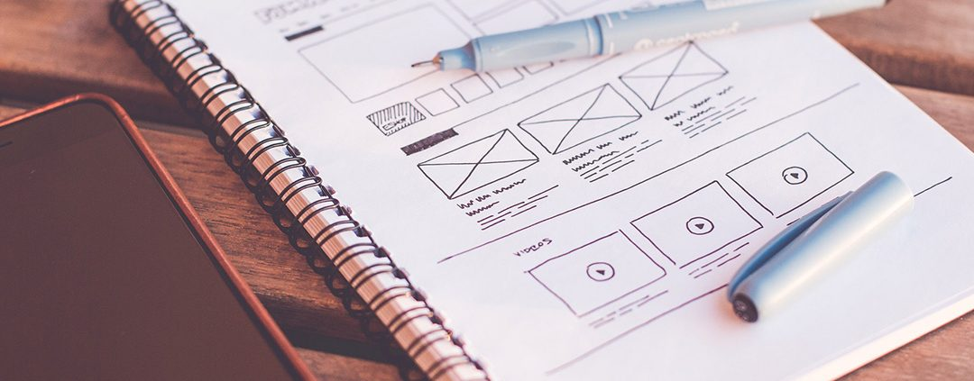 A mockup of a web design on pen and paper