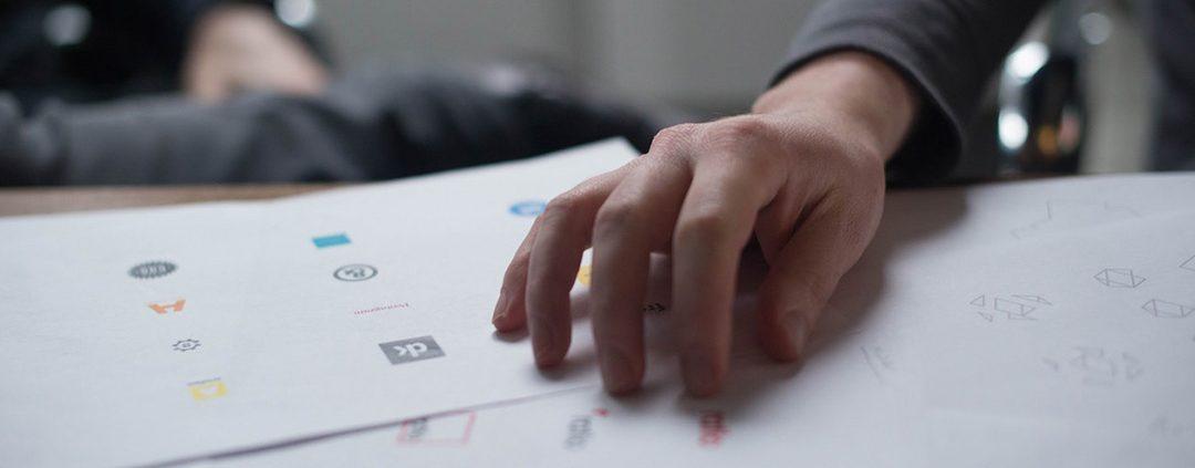 A person designing a logo