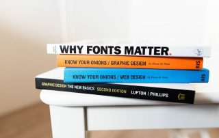 A collection of books on graphic design